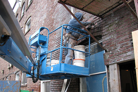 Image of man repairing exterior brickwork